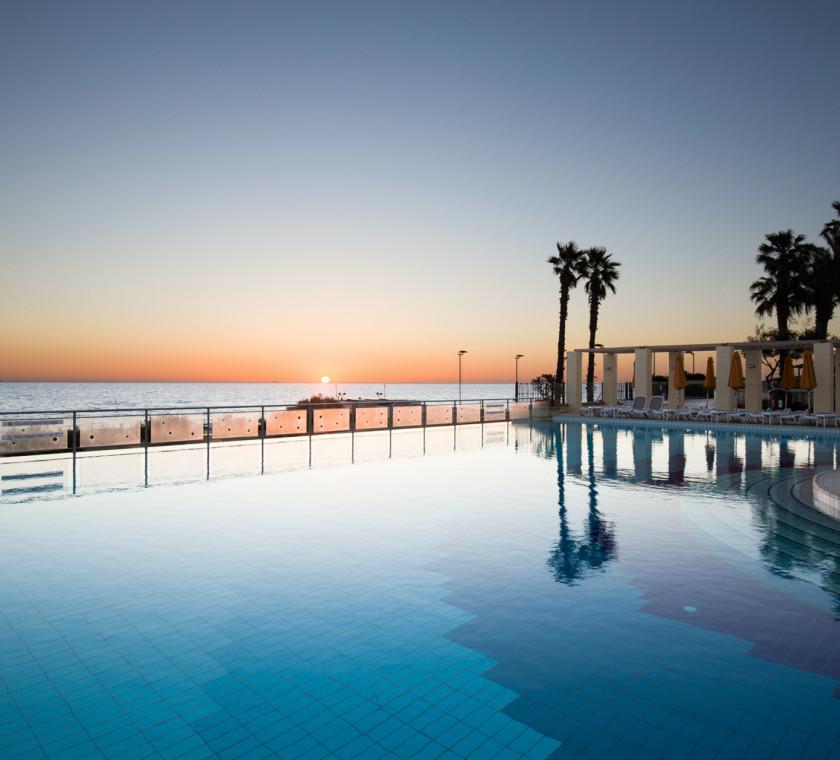 Beachside outdoor pool at sunrise