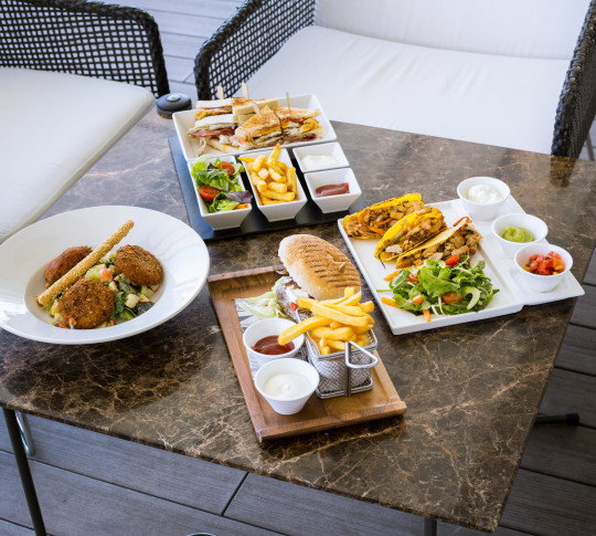 Lunch for four of salad, tacos, and sandwiches with fries