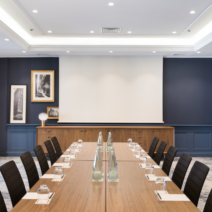 Conference room with screen and meeting table